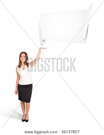 Beautiful young woman presenting abstract origami copy space isolated on white