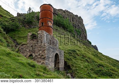 The Ruins Of Old Diatomite Factory And Rusty Chimney In Isle Of Skye, Scotland, Uk