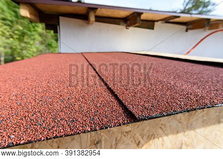The Roof Of A Small House Is Covered With A Roof - Soft Bitumen Roll Tiles