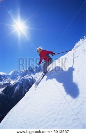 Woman Skiing On Mountain