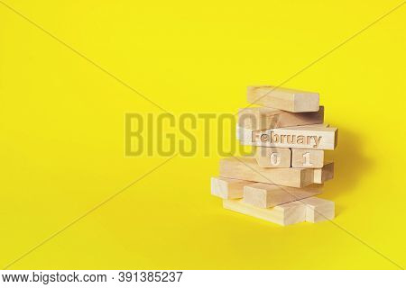 February 1st . Day 1 Of Month, Calendar Date. Wooden Blocks Folded Into The Tower With Month And Day