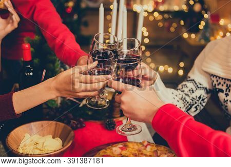 Christmas And New Year Party With Friends. Drinking Red Wine And Champagne For Celebration On Holida
