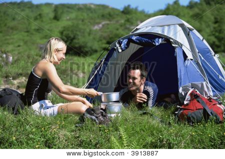 Couple Smiling Whilst Camping