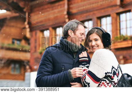 Winter Portrait Of Happy Romantic Couple Posing Outside