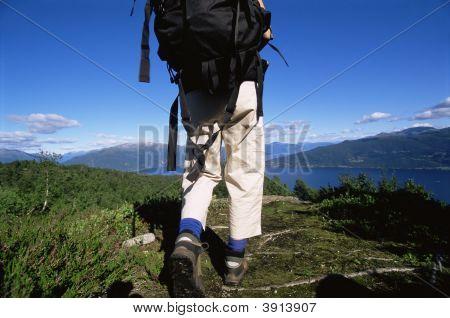 Woman Walking On Rough Terrain