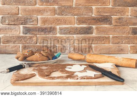 Preparation For Halloween.making Homemade Gingerbread Cookies For Halloween On Brick Wall Background