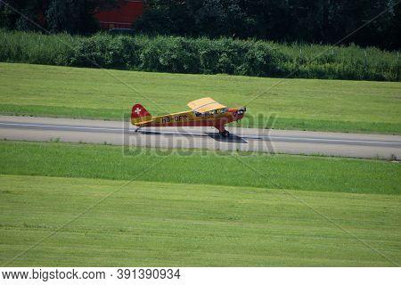 Piper L4 Nostalgic Airplane Is Taxiing At The Airport Altenrhein Near Saint Gallen In Switzerland 10