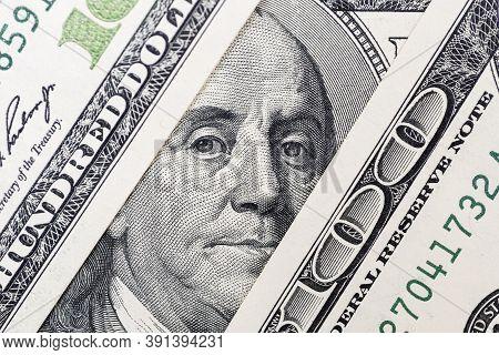 Benjamin Franklin's Eyes From A Hundred-dollar Bill. The Face Of Benjamin Franklin On The Hundred Do