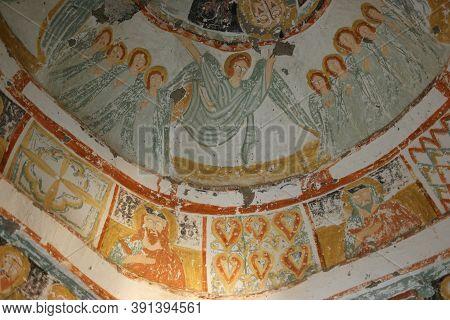 Frescoes On A Wall Of Cave Church, Goreme, Cappadocia, Turkey. Wall Art Of Old Frescoes In Church. H