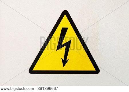 Generic High Voltage Danger Sign, Symbol. Sign Of Danger High Voltage Symbol On The White Wall. Warn