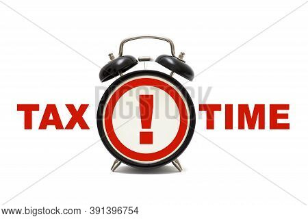 Black Alarm Clock On White Background With Word Tax Time. Tax Time Concept Clock Closeup Isolated On