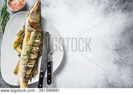 Grilled Zander, Walleye Fish With Herbs And Lemon On A Plate. Gray Wooden Background. Top View. Copy