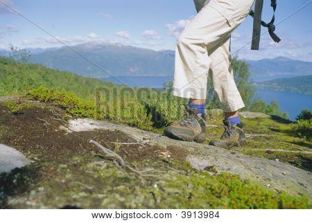 Woman Walking Along Rough Terrain