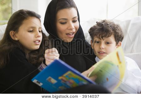 Middle Eastern Family Reading Book Together At Home
