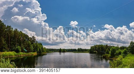 Beautiful Lake In The Woods With Pine Trees On The Shore For Summer Vacation. Travel To Ukraine.