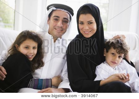 Middle Eastern Family At Home On Sofa