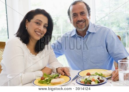 Middle Eastern Couple Sat At Table Eating Food