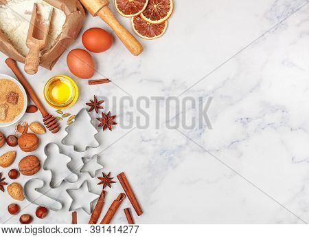 Christmas Baking Background With Ingredients For Making Homemade Gingerbread Cookies On A Marble Bac