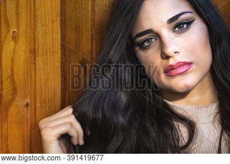 Portrait Of A Beautiful Brunette Girl With Hazel Eyes