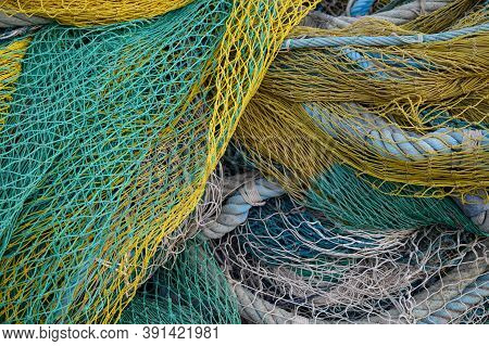View On Fishermans Tackles And Nets Near Coastal Town Terracina, Latina, Italy On Sunset
