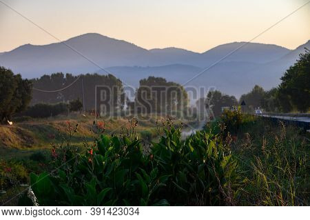 View On Very Fertile Agricultural Valley Plain Of Fondi, Latina With Fields And Greenhouses On Sunri