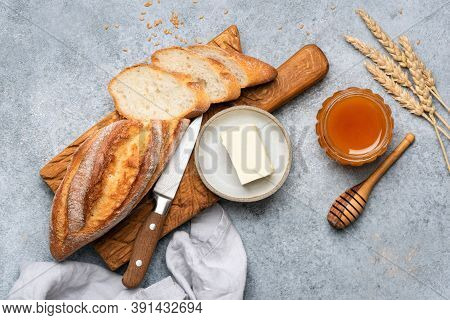 Bread, Butter And Honey Still Life. Top View. Baguette Bread With Butter And Honey