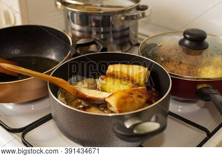 Traditional Cuisine With Stuffed Cabbage Rolls On The Stove