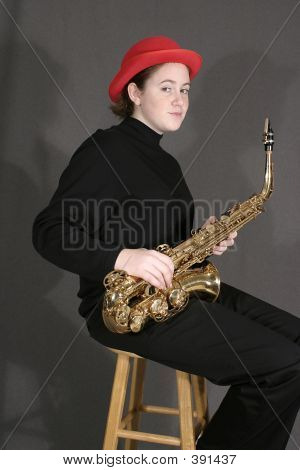Student Holding Sax