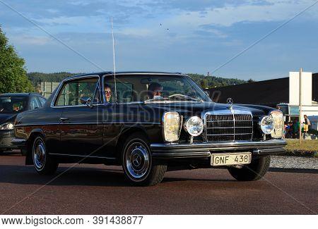 Rattvik, Sweden - July 27, 2013: Classic Car Week Rättvik, Black Retro Car Mercedes-benz W115.  Vint