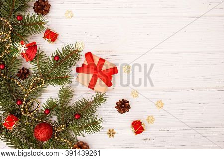 Christmas Greeting Card Composition. Gift With Christmas Tree, Decoration On White Wooden Background
