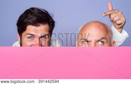 Hair Loss, Baldness. Middle Aged And Senior Bald Man Face Close Up. Copy Space For Text. Paper Baner