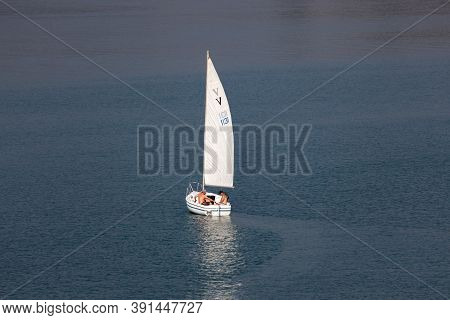 Lost Creek Lake Near Prospect,  Oregon / Usa - September 7, 2014:  Three Men In A Small White Sailbo