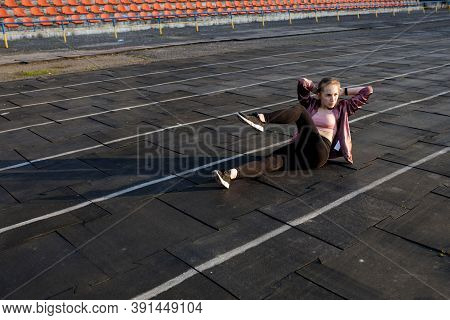 Female Athlete Preparing Legs For Cardio Workout. Fitness Runner Doing Warm-up Routine. Woman Runner