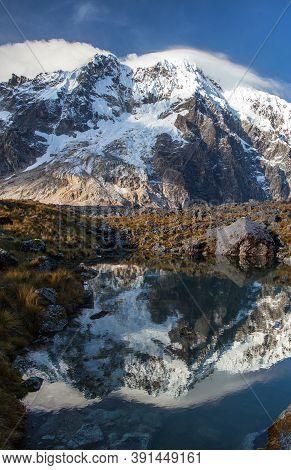 Evening View Of Mount Salkantay Mirroring In Lake, Salkantay Trek In The Way To Machu Picchu, Cuzco