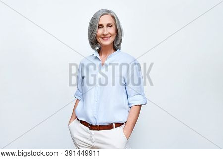 Smiling Confident Middle Aged Business Woman Standing Isolated On White Background. Old Senior Busin