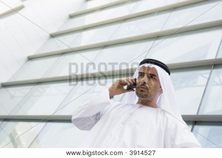 Middle Eastern Business Man Stood Outside Offices On Cell Phone