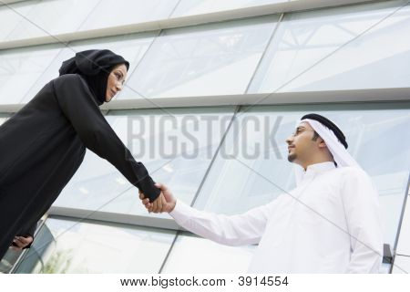 Middle Eastern Couple Shaking Hands
