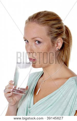 a young woman drinking a glass of fresh, clean water. mineral water and tap water dip.