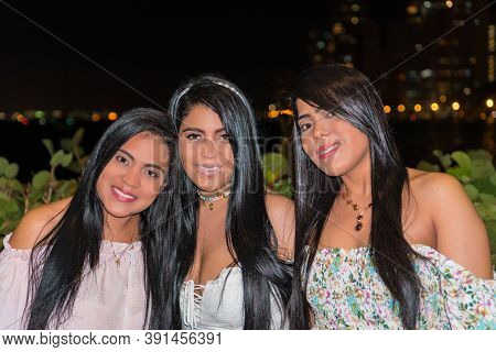 Beautiful Young Latinas Having Fun At Night