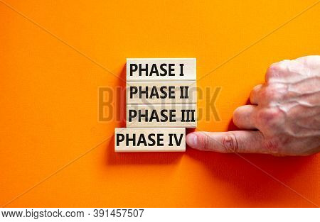 Time To Phase 4. Wooden Blocks Form The Words 'phase, 1, 2, 3, 4' On Orange Background. Male Hand. B
