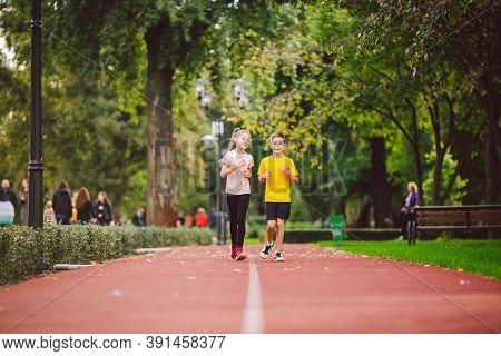 Kids Run. Healthy Sport. Child Sport, Heterosexual Twins Running On Track, Fitness. Joint Training.