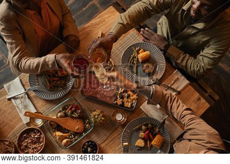 Top View Background Of Multi-ethnic Group Of People Enjoying Feast During Dinner Party With Friends