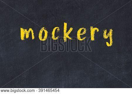 Chalk Handwritten Inscription Mockery On Black Desk