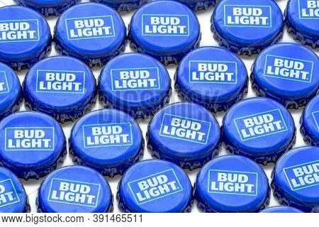 Calgary, Alberta, Canada. Oct 25, 2020. Bud Light Crown Beer Bottle Caps On A Clear Background.
