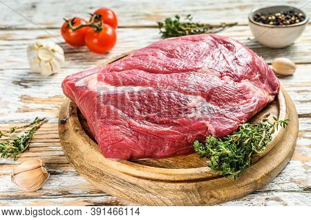 Raw Brisket Beef Cut On A Wooden Board. Black Angus Beef. White Background. Top View