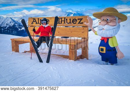 Alpe D Huez, France - January 15, 2018: Funny Interesting Winter Place For Rest With Happy Skier Wom