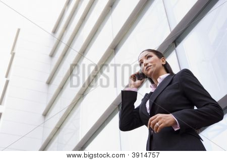 Middle Eastern Business Woman Stood Outside Offices On Cell Phone