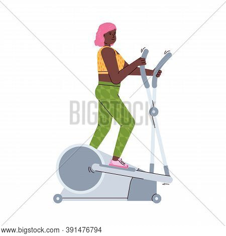 Young Woman Training On The Elliptical Machine. Sport Equipment For Fitness Exercises In Gym Or Home