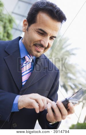Portrait Of Middle Eastern Business Man Using Blackberry