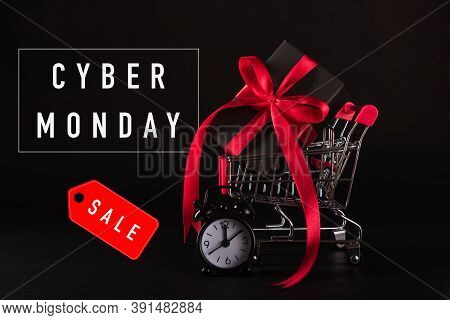 Cyber Monday Sale Shopping Concept, Gift Box Wrapped Black Paper And Red Bow Ribbon Present In The S